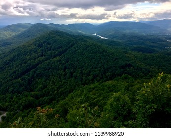 A view looking at the Cumberland Gap and just beyond it the point where the states of Virginia, Kentucky, and Tennessee come together on a stormy summer day.