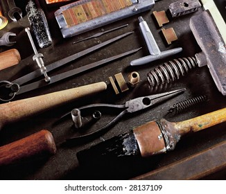 View looking down on a table of various Book Binding tools for use by hand