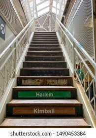 """View looking up at empty stairwell for elevated """"el"""" train for green and brown lines going to Harlem & Kimball in Chicago Loop"""