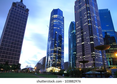 View looking up at the modern office buildings at night in Shanghai