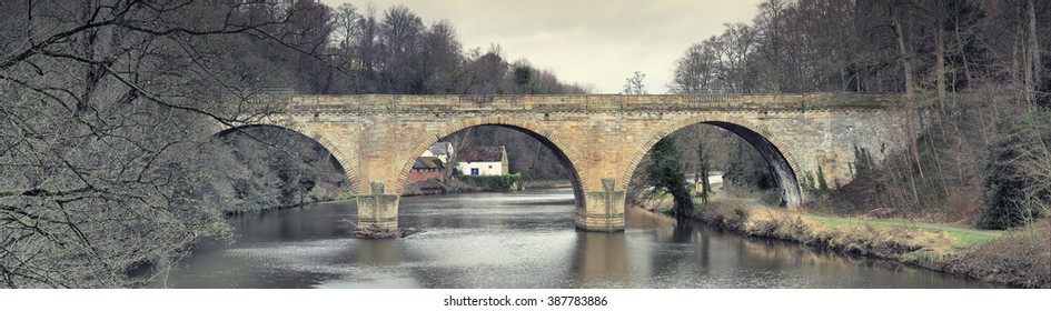View looking north towards Prebends Bridge, a stone structure that spans the River Wear in Durham.