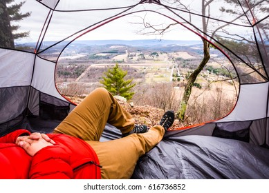 View looking out at a scenic mountain from inside a tent