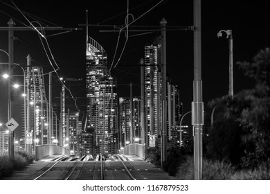 View looking through Gold Coast's light rail tram system with Surfers Paradise cityscape in the background. Black and White