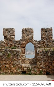 view from the loophole of the fortress of Alanya to the port and the sea