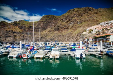 view of Los Gigantes marina with yachts and boats in Tenerife, Canary islands, Spain
