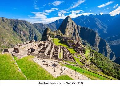 View of the Lost Incan City of Machu Picchu near Cusco, Peru. Machu Picchu is a Peruvian Historical Sanctuary and a UNESCO World Heritage Site. Machu Picchu is  located in the Cusco Region in Peru.