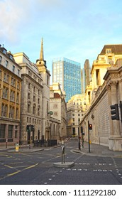 View of Lothbury Street in London Banking District, overlooking a skyscraper and St. Margaret's Church on the left.