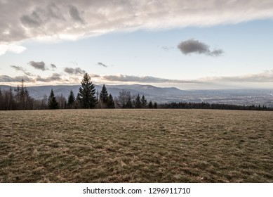 view from Loucka hill covered by mountain meadow in Slezske Beskydy mountains in Czech republic during nice late autumn day with blue sky and clouds