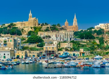 View of Lourdes Chapel and Ghajnsielem Parish Church from Mgarr Harbour on Gozo Island in Malta.