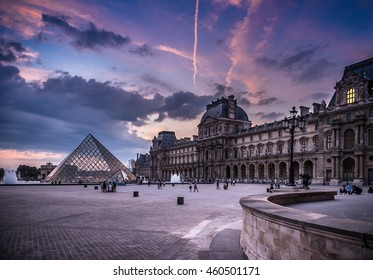 View of the Louvre Museum by sunset in Paris, France.