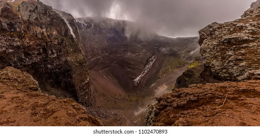 A view of low clouds spilling into the crater of Mount Vesuvius, Italy