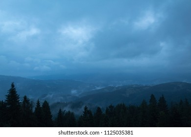 view of low mountains on a cloudy day