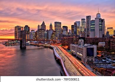 View of Lower Manhattan with Brooklyn Bridge at Sunset, New York City