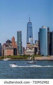 view of lower manhattan skyline with the one world trade center and the one new york plaza building
