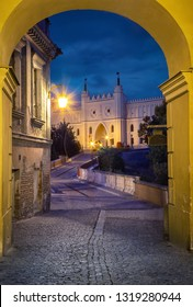 View of Lublin Castle through the arch at dusk in old town of Lublin, Poland