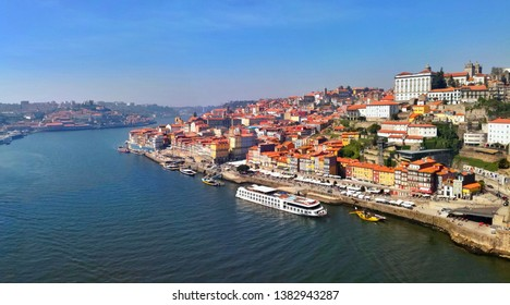 View from Luis I Bridge on the coast of Porto city and Douro river.