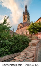 View of the Lutheran cathedral of Sibiu, in the old town, during the sunset.
