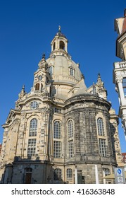 View of Lutheran Frauenkirche church (Church of Our Lady) on background of bright blue sky from the corner of Rampiche Street in Dresden, Saxony, Germany.