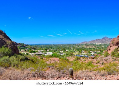 View of luxury homes / houses in Paradise Valley from the Echo Canyon Recreation Area hiking trail on Camelback Mountain in Central Phoenix, AZ and Scottsdale, Arizona