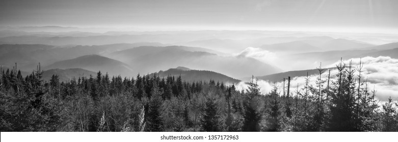 view from Lysa hora hill in autumn Moravskoslezske Beskydy mountains in Czech republic with many mountain ranges and mist in lower altitudes