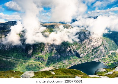 View of Lysefjord with clouds from Kjerag mountain, Norway. Summer landscape