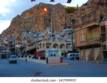 View of Maaloula City Center with portraits of the Assad family. It is evening. Only here and in two other cities are spoken aramaic language. Maaloula, Syria, Middle East. November 23, 2007.