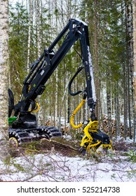 View of a machine operating a raw piece of wood.Felling of the forest