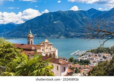 View of Madonna del Sasso Church above Locarno city and the Locarno lake in Ticino, Switzerland