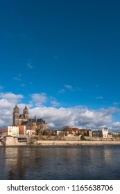 View of Magdeburg Cathedral and Elbe river from another side, Magdeburg, Germany, Spring, sunny day, clouds