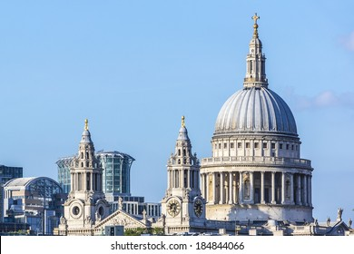 View of magnificent St. Paul Cathedral from Thames at sunset. It sits at top of Ludgate Hill - highest point in City of London. Cathedral was built by Christopher Wren between 1675 and 1711.