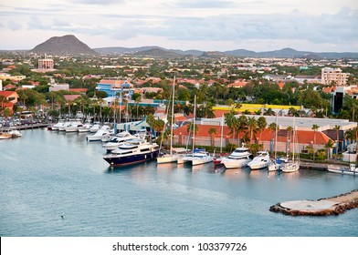 View of the main harbor on Aruba looking inland. This photo, from a cruise ship, looks down over the city and boats. Dutch province named Oranjestad, Aruba - beautiful Caribbean Island.