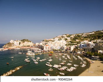 View of the Main Harbor and Port at Ponza, Italy. Boats at sea and houses on the mountainous coastline