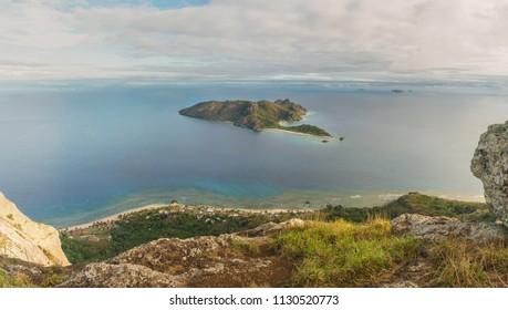 View from the main peak of Wayalailai in the direction of Kuata island and Fiji mainland - Viti Levu, an hour before sunset, Yasawa Island group, Fiji, Oceania