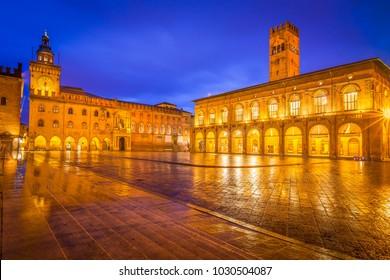 View of Main Square (Piazza Maggiore) under clear blu sky with Palazzo d'Accursio  (left) and Palazzo Podestà (right), Bologna, Italy
