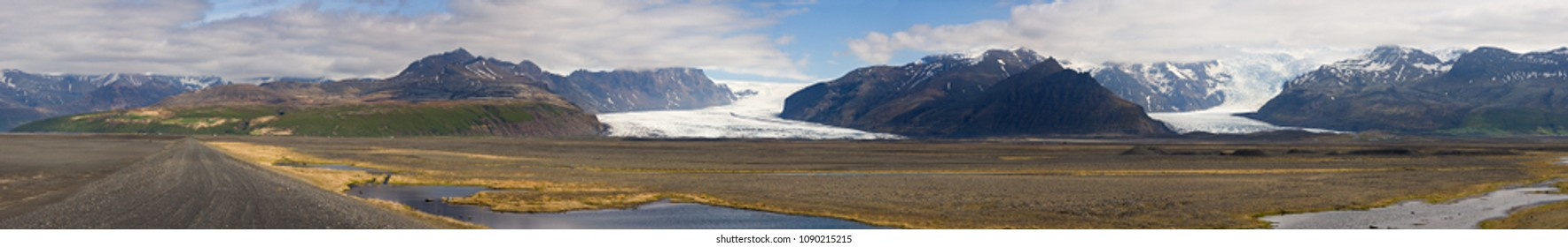 View from the main street 1 to the Skaftafell National Park, Iceland. In the left you can see the Svartifoss, the glacier tongues belong to the Vatnajoekull.