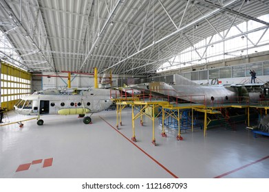 """View of the maintenance hall with planes standing in aircraft fixtures for repair. Press-tour to the State Aircraft Repair Plant """"410"""". June 7, 2018. Kiev, Ukraine"""