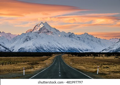 View of the majestic Aoraki Mount Cook with the road leading to Mount Cook Village. Taken during winter in New Zealand.