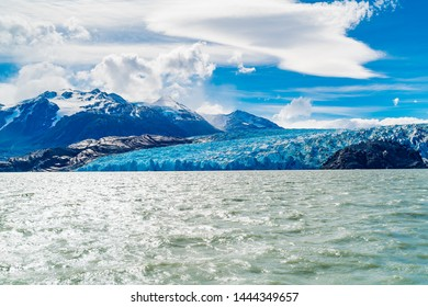 View of the majestic blue ice of Glacier Grey on the water of Lake Grey in Torres del Paine National Park, Chile