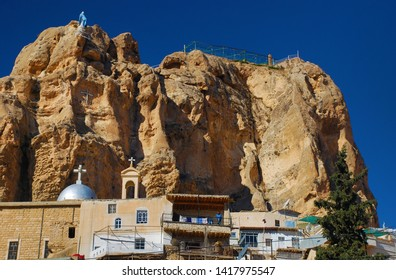 View to the majestic rocks and ruins of the city. Autumn comes. Only here and in two other cities are spoken aramaic language. Syria before the war. Maaloula, Syria, Middle East. November 23, 2007.