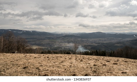 view from Mala Kycera hill in Moravskoslezske Beskydy mountains in Czech republic during late winter day