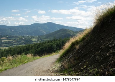 View from Mala Stolova, Near Celadna, Beskids ( Beskydy ), Western Carpathians, Czech Republic / Czechia. Road and path for tourists. Lysa hora mountain in the distance.