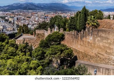 View of Malaga Gibralfaro Walls. Gibralfaro castle (Castillo de Gibralfaro) was built in 929AD on high hill overlooking Malaga city. Malaga, Andalusia, Spain.