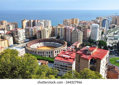 View of Malaga, Spain with the Plaza de Toros (bullring) in the foreground.