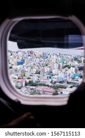 View of Male, Maldives from seaplane window. This is the main city where the international airport is. You must go here to transfer to the resort islands of the Maldives.