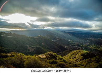 view from Malibu hills Topanga  canyon California beautiful sunset drive in USA America sunset with flaire during golden hour on mullholland drive Los Angeles City of angels national park Malibu