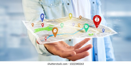 View of a Man holding a 3d rendering pin holder on a map