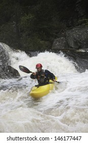 View of a man kayaking in rough river