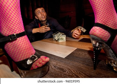 View of man offering money to a stripper on stage