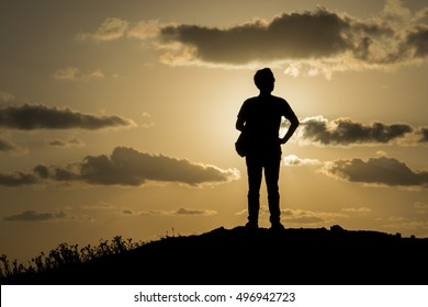 View of man standing outdoor on dawn background.
