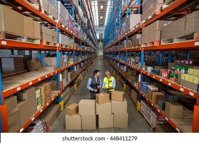 View of managers are checking some cardboard boxes in a warehouse